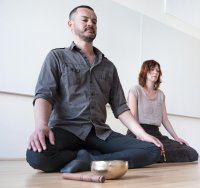 Two students meditating