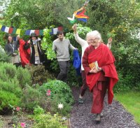 Lama Shenpen leading students around the stupa
