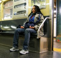 Woman meditating on train